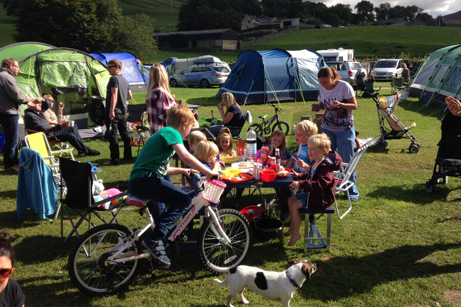 Kids having fun camping Bolton Abbey North Yorkshire